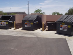 well0managed dumpsters in separate enclosures